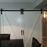 Large barn door and barn door hardware set-up for conference room