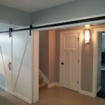 large barn door opening with long Goldberg Brothers barn door hardware set-up