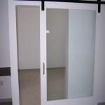 Conference room managed with barn door and privacy glass, using Goldberg Brothers barn door hardware